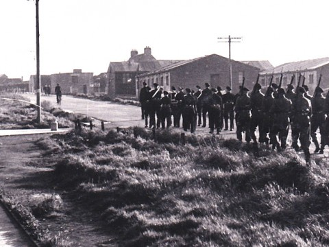 Royal Marines of 19th Battalion marching up South Road towards Haybrake, Lyness. © Orkney Library & Archive.
