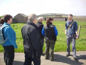 Explaining gas decontamination on a Lyness guided walk around Lyness led by IoHDT Wartime Heritage Officer Gavin Lindsay