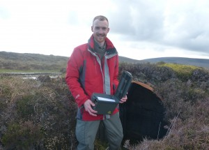 Geocache Box being placed 'somewhere' on WeeFea by IoHDT Wartime Heritage Officer Gavin Lindsay